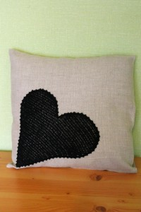 Linen cushion cover with crocheted heart